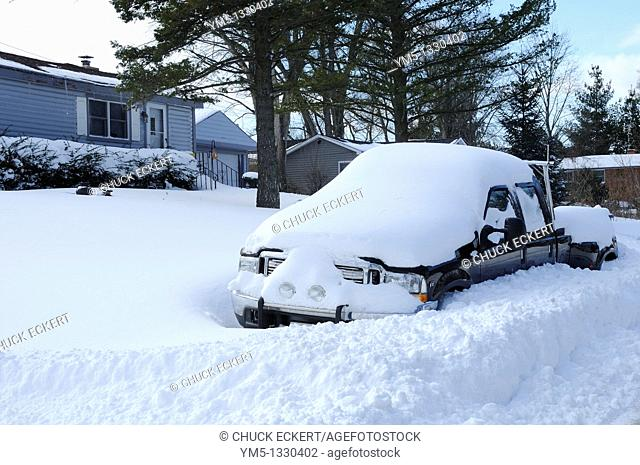Truck buried in snow after blizzard