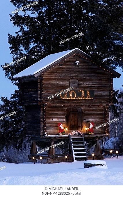 Log cabin decorated with Christmas lights