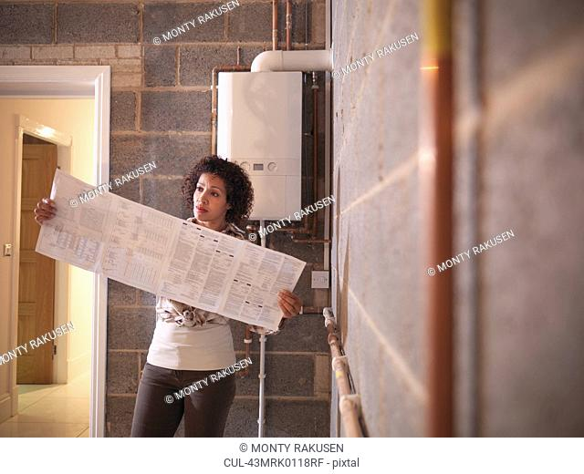 Woman reading oversized brochure