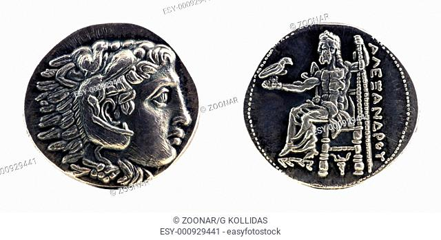 Greek silver tetradrachm from Alexander the Great showing Hercules wearing lion skin at obverse and Zeus at reverse