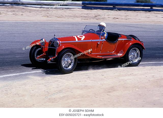 An Alfa Romeo Milano red car shown at the 35th Concours D Elegance Show in Pebble Beach, Carmel, CA