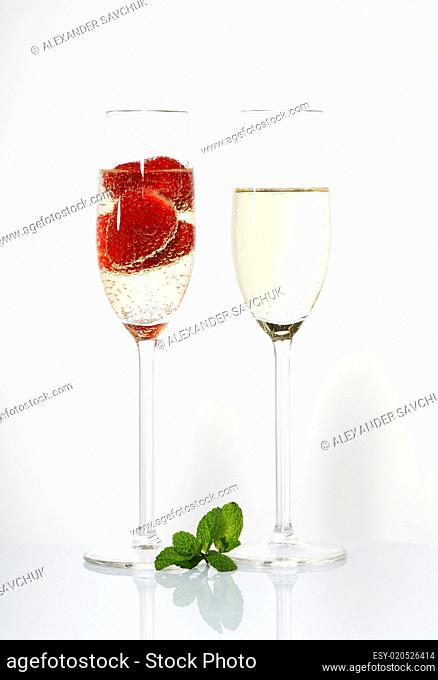 Two glasses of sparkling wine and strawberry