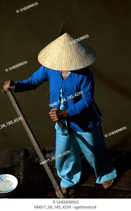 High angle view of a woman rowing a boat, Vietnam