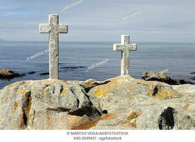 The crosses in memory to the fishers passed away while collecting the goose barnacles that do occur on the coastal rocks. Punta Roncudo, Galicia
