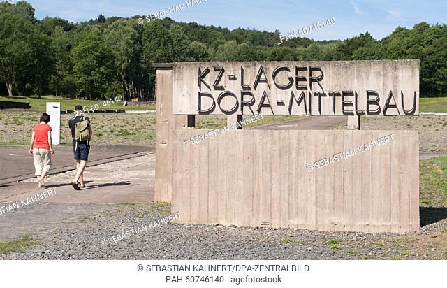 Visitors walk on the concentration camp memorial site in Mittelbau-Dora, Germany, 06 August 2015. During a summer camp young adults work on the visualization of...