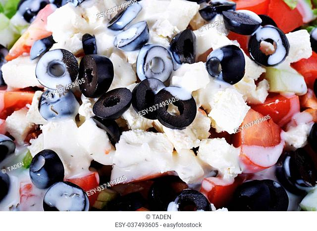 Salad with olives and cheese from fresh vegetables