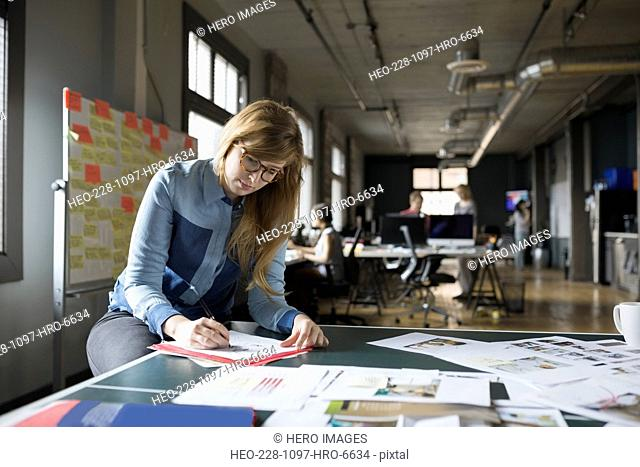 Creative businesswoman working in office