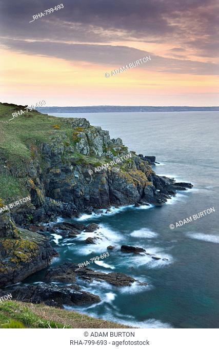 Sunrise above the headland at Hot Point on the Lizard Peninsula, Cornwall, England, United Kingdom, Europe