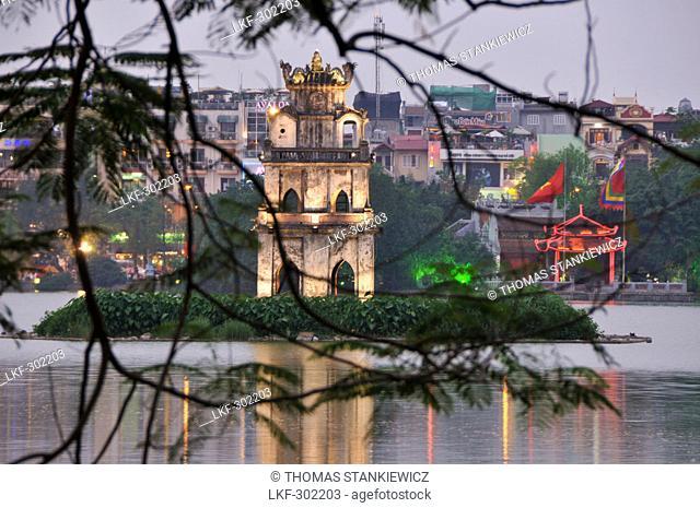 View across Hoan Kiem lake with Tap Rua, turtle tower, old town of Hanoi, Vietnam