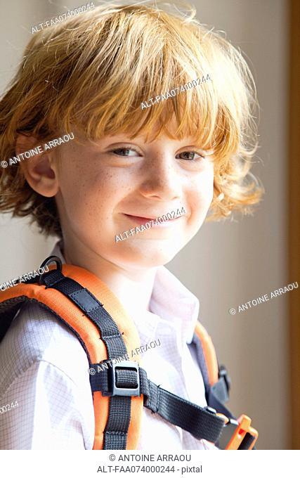 Little boy wearing backpack, portrait