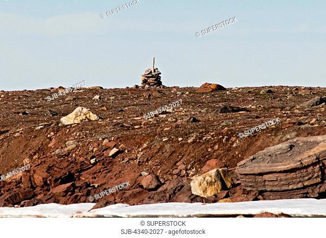 A rock cairn on Andoyane island, Liefdefjorden, northwest Svalbard, Norway, in summertime