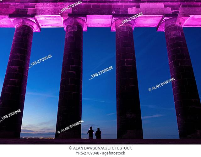 Penshaw Monument, Penshaw, Tyne & Wear, north east England, United Kingdom. Couple watching sunset from The Earl of Durham's Monument
