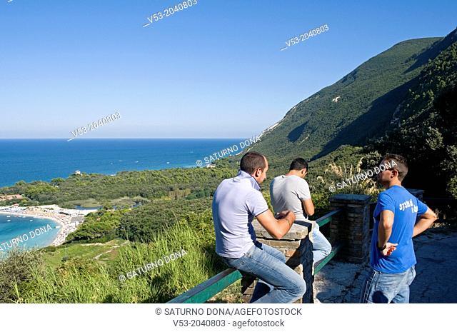 Young men in Portonovo, Conero Riviera Natural Park, Marche, Italy
