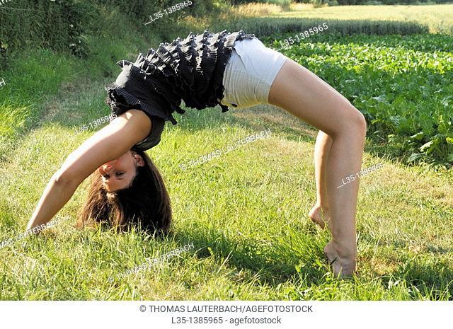 Young woman doing a cartwheel
