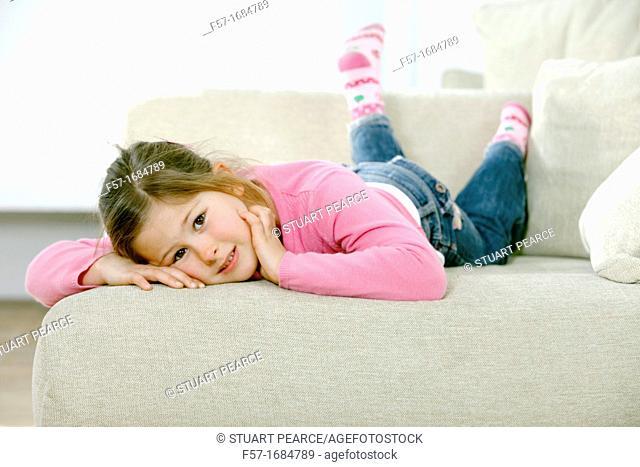 Girl laying on coach
