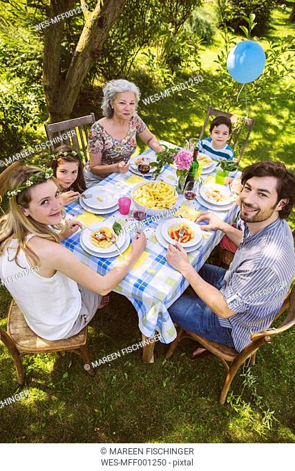 Family of three generations at a garden party
