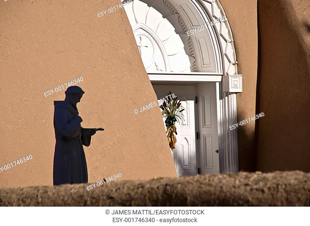 The silouette of a statue of St  Francis at a church in Taos, New Mexicon
