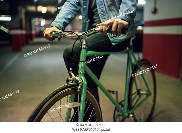 Man with his fixie bike in a garage