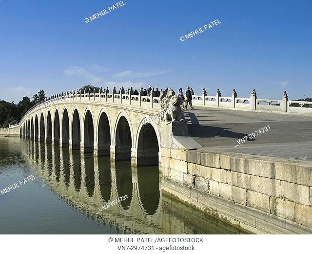 Reflection of the 17 arch Summer Palace park bridge in Beijing, China