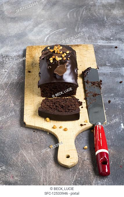 Chocolate cake on a wooden plank on a grey backdrop