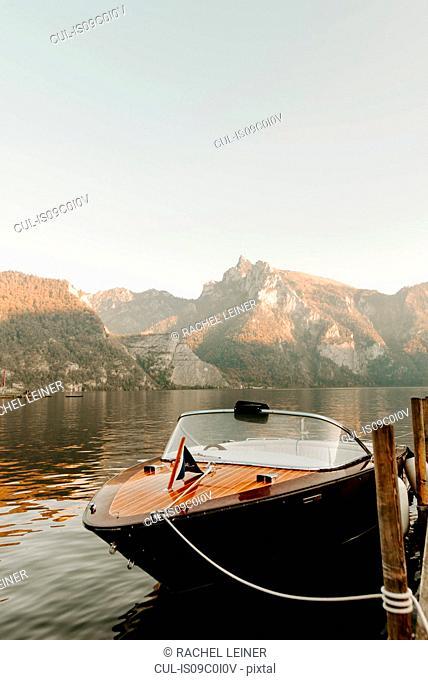 Motorboat moored at lake pier, Hallstatt, Upper Austria