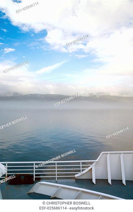 Vertical composition passenger ferry glides along inland waterway