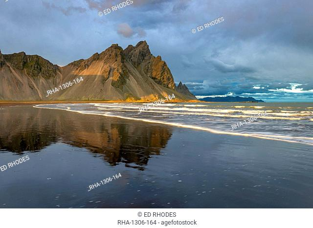 View of the mountains of Vestrahorn from black volcanic sand beach at sunset, Stokksnes, South Iceland, Iceland, Polar Regions
