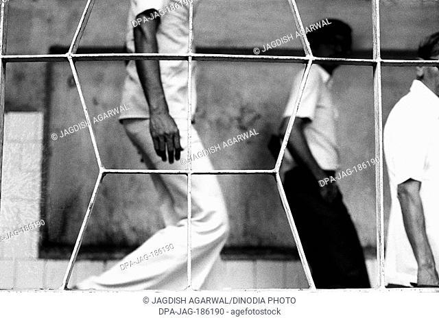 Three men walking down Mumbai Maharashtra India Asia 1982