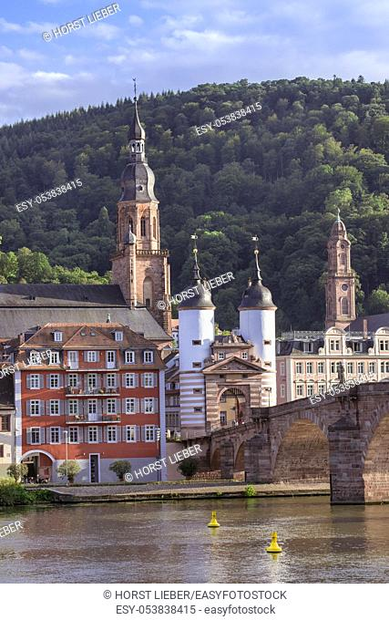 The historical old bridge gate with two towers in Heidelberg and in the background the Church of the Holy Spirit , Baden Wuerttemberg, Germany, Europe