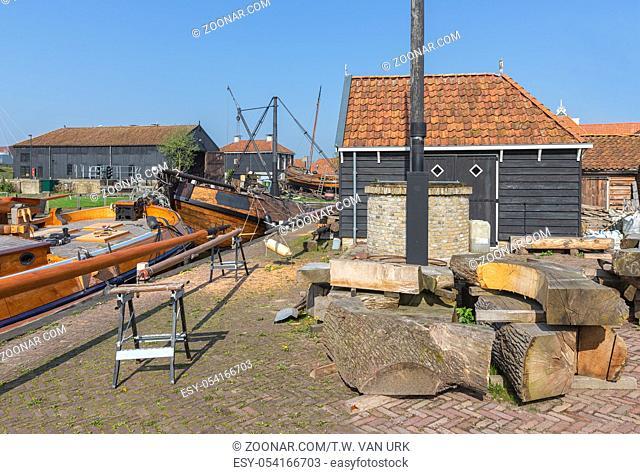 Historical ships anchored near shipyard in harbor Dutch fishing village Workum