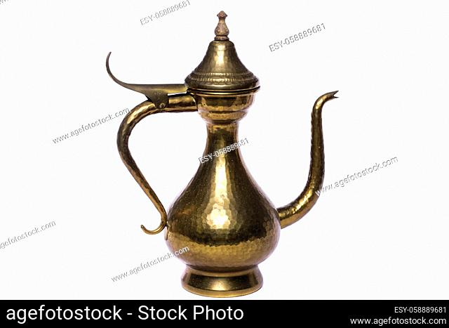 Close up view of a copper wine vase isolated on a white background