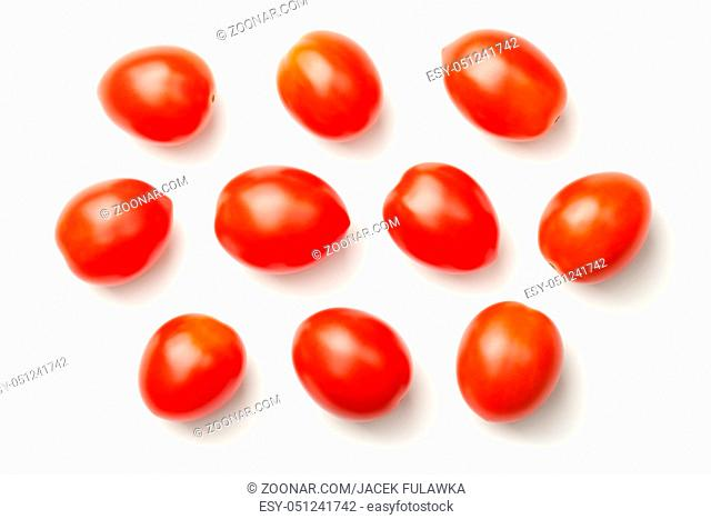 Red pepper cherry tomatoes isolated on white background. Top view