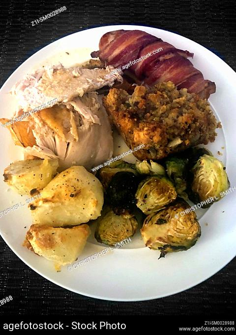 Roast Turkey with all the trimmings of Christmas on a white plate