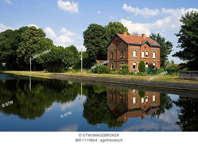 Canal du Centre, near Boat Lift number 2, Unesco World Heritage Site, house reflecting in the water, Houdeng Goegnies, Hainaut Province, Belgium