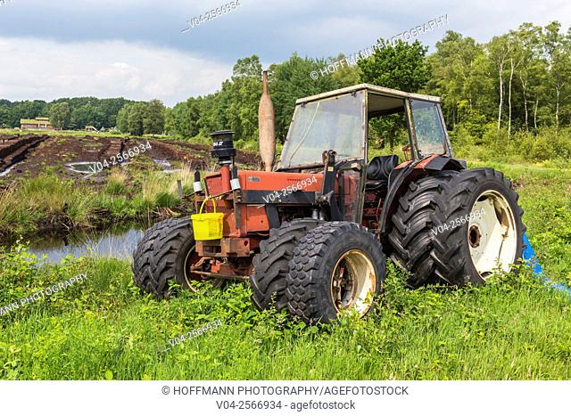 Vintage tractor in the middle of a bog, Lower Saxony, Germany, Europe