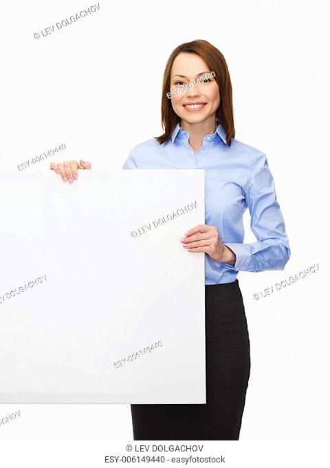 business, advertisement and education concept - friendly young smiling businesswoman with white blank board