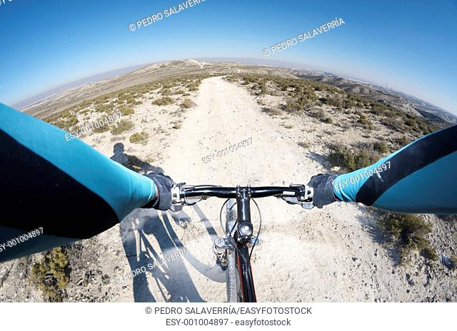 forefront of the handlebars of a bicycle on a walk through a barren landscape, South Zaragoza, Aragon, Spain