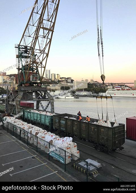 Unloading cement from the train in Vladivostok, Far East, Russia, Russian