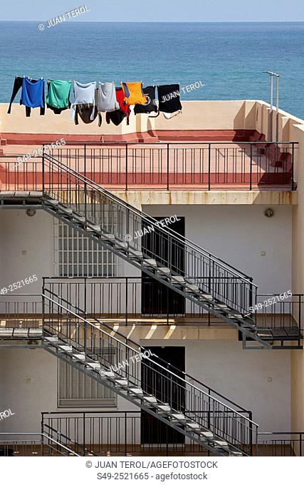 Clothes drying on clotheslines on a roof, Cullera, Valencia, Spain