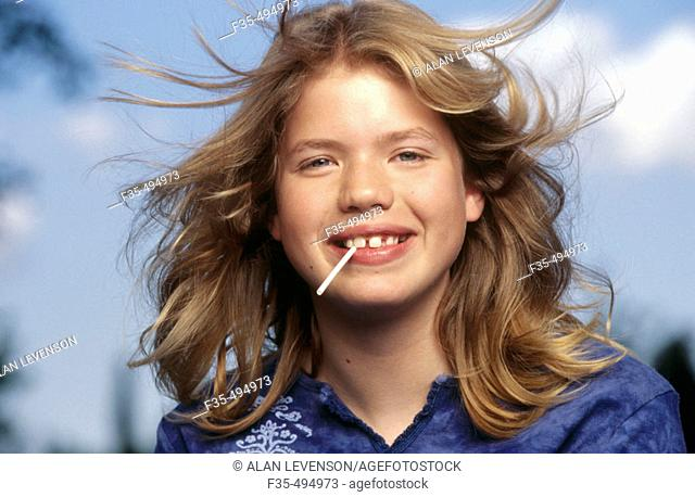 Headshot of Adolescent girl with Lollipop