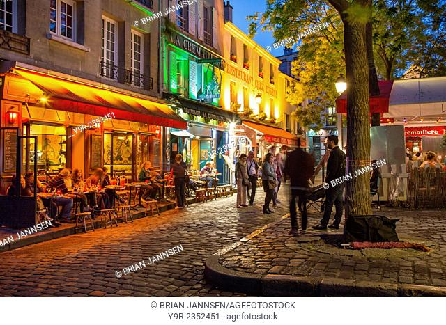 Evening scene in Place du Tertre, Montmartre, Paris, France
