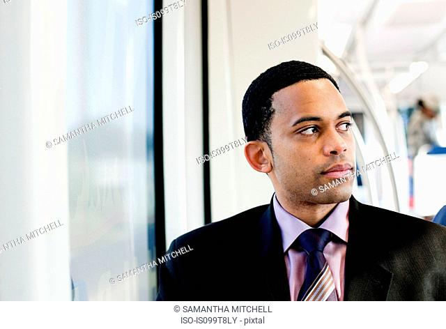 Businessman on a train, looking away