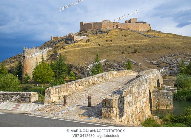 Medieval bridge over Abion river and Osma castle. El Burgos de Osma, Soria province, Castilla Leon, Spain