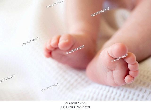 Baby girl's barefeet, close up