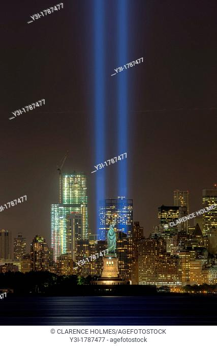 The twin beams of light of the Tribute in Light, an annual memorial to the events of September 11, 2001, shine into the evening sky in New York City on either...