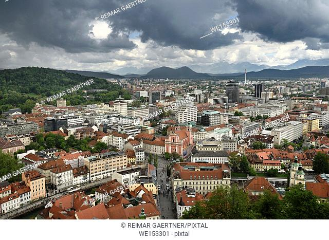 Ljubljana Slovenia with Karawanks Kamnik Savinja limestone Alps and pink Franciscan Church of the Annunciation Preseren Square and Ljubljanica canal