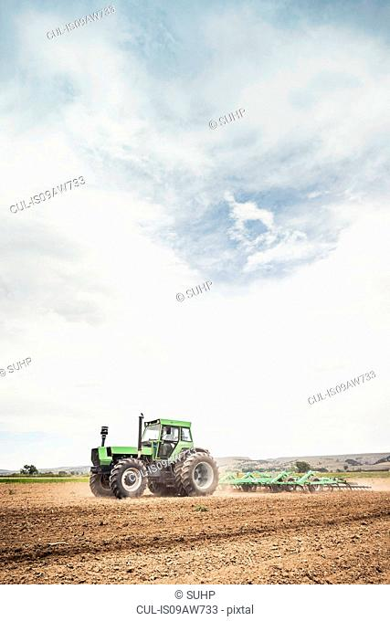 Farmer ploughing field with tractor