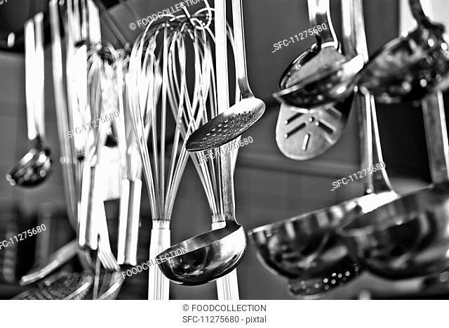 Cooking utensils hanging in a restaurant kitchen