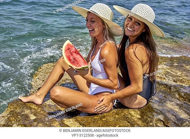 Two young women. Chersonissos, Crete, Greece