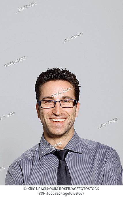 Studio shot of man, smiling